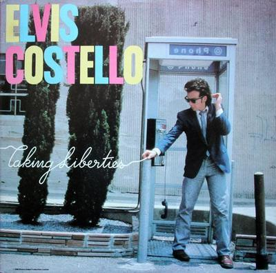 COSTELLO, ELVIS - TAKING LIBERTIES U.S. pressing, red labels (LP)
